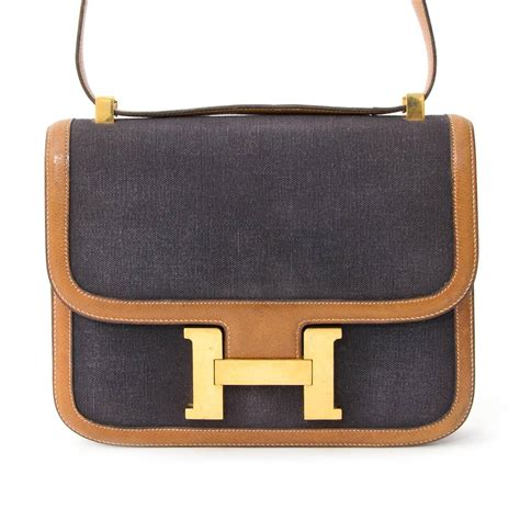 Constance Gold Shw hermes constance leather canvas at 1stdibs