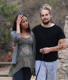 pregnant zoe saldana shares kisses with husband marco