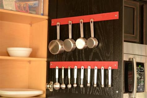 how to organize mugs in cabinet organizing measuring cups and spoons infarrantly creative
