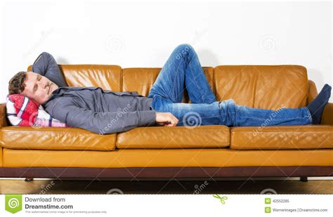 laying couch man laying on couch stock photo image 42552285