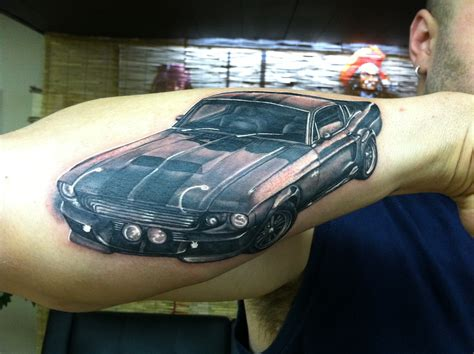 mustang tattoo on forearm
