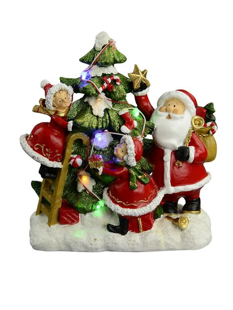 resin santa christmas helpers decorating tree scene with