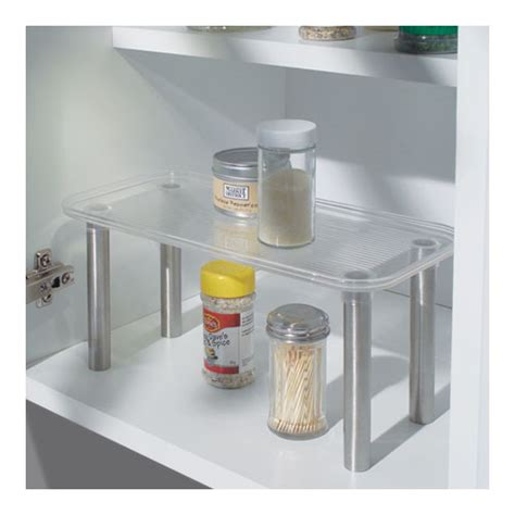 stainless steel and clear plastic helper shelf in cabinet