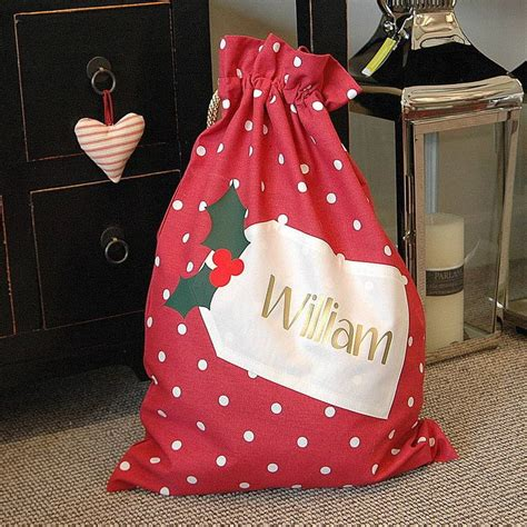 personalised christmas santa sack by the alphabet gift