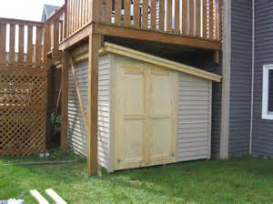 deck storage to maximize space beneath the deck