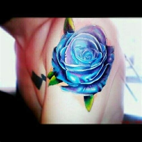 blue rose tattoo and piercing blue purple inkgasm piercings