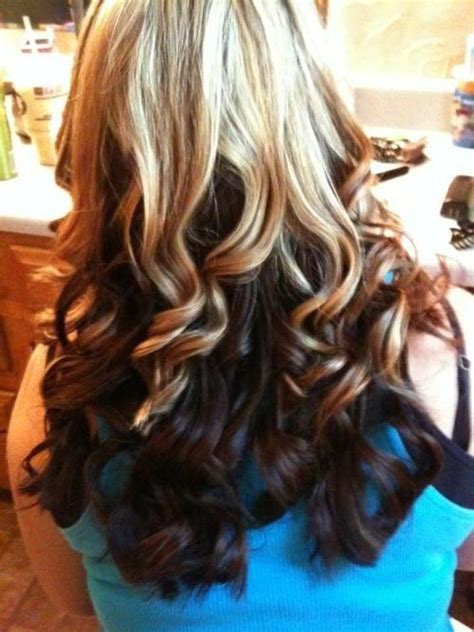 my hair under top layer is wacy blonde on top brown underneath curly blonde on top with