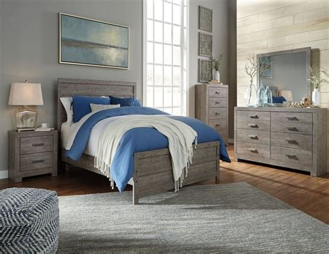 panel bedroom set culverbach panel bedroom set from ashley coleman furniture