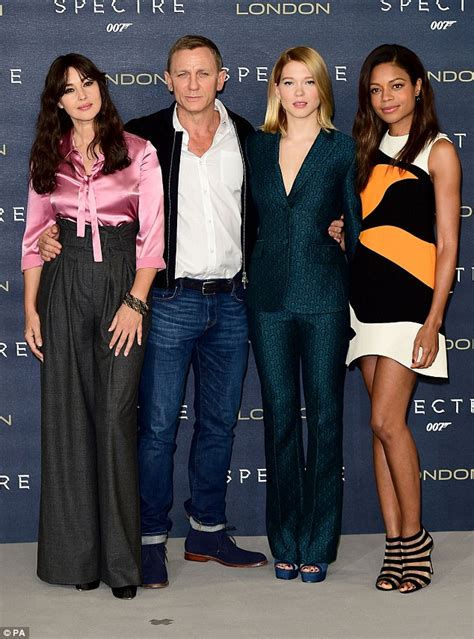 daniel craig clings onto his bond girls at spectre world daniel craig showcases a more casual side to his style as