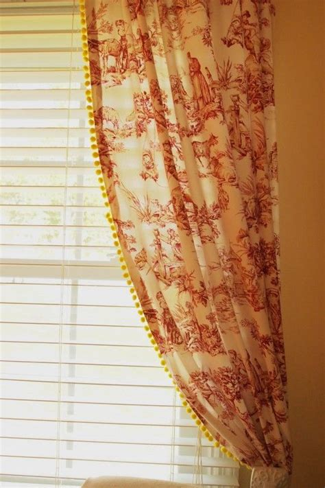yellow toile curtains red toile curtains with yellow pom pom fringe toile