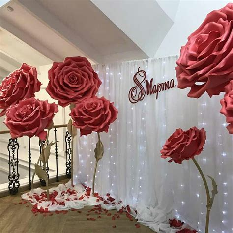 Find the rose petals to decorate your backdrop with at www