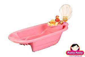 pink baby bath tub and tub organizer for potty
