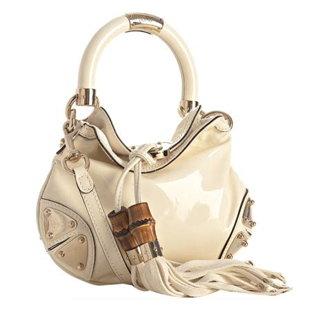Mini Gucci Indy Bag by Gucci Ivory Patent Indy Bamboo Tassel Mini Bag In White