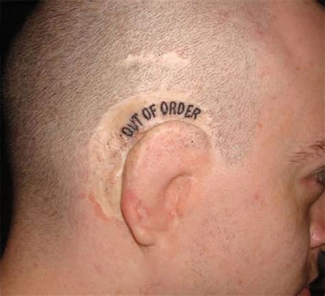 30 weird and unusual ear tattoos designs 23