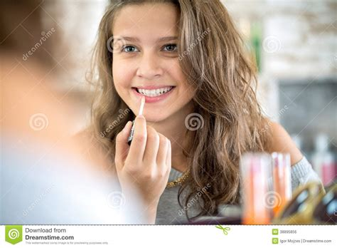 Beautiful Young Girl Putting On Makeup In Bathroom Hot