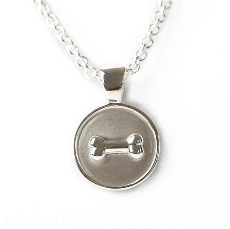 sterling silver bone on disc pendant welch designs