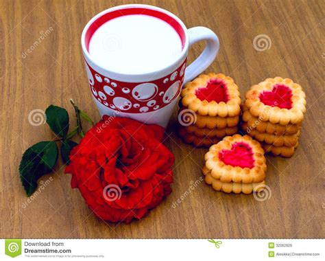 Stack Cup Oce Dan Cookies shaped cookies and a cup of milk royalty free