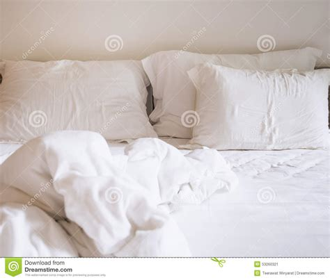 bright morning pillow top beds bed sheet mattress and pillows messed up stock photo