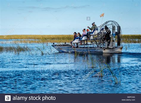 driving boat in florida captain driving boat stock photos captain driving boat