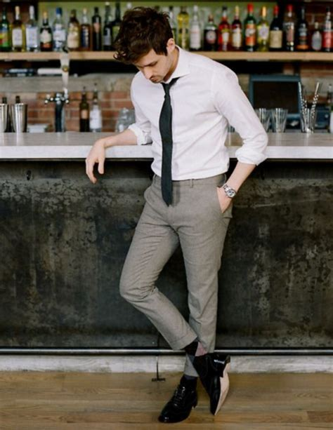 picture of grey a white shirt a black tie and shoes