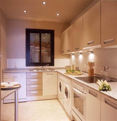 small kitchen remodeling ideas with elegant pendant lighting and neutral wall color kitchen iluminar la zona de trabajo en tu cocina el blog de