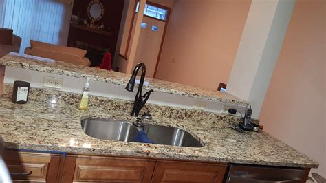 stainless steel sink with bronze faucet minneapolis kitchen remodel company