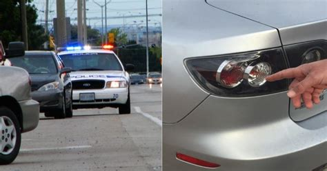 why do cops touch your light here s why cops touch a car s light when they pull