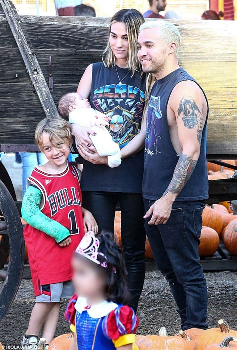pete wentz and his family fawn over saint lazslo during