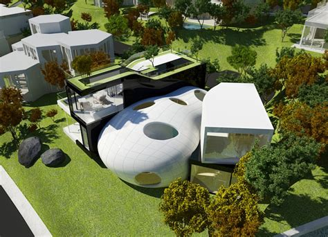the cocoon house is an amorphous green roofed retreat on a