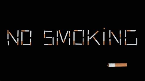 no smoking sign black background time lapse of no smoking sign made of cigarettes on a