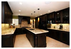 elegant dark kitchens granite countertop glass tile backsplash brown kitchen cabinets idea