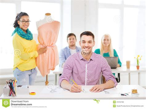 fashion illustration education smiling fashion designers working in office stock