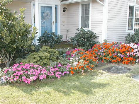 Soft Garden Landscaping With Flowers Grass And Trees Gardening Plants And Flowers