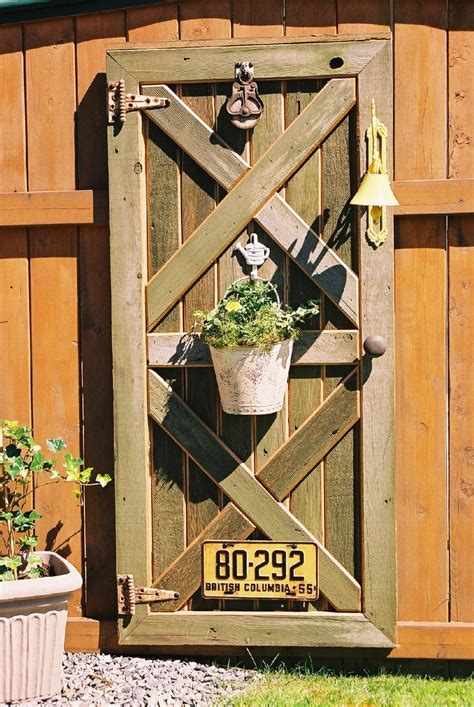 custom barn door fence decor with plant hanger hinges and door knob fence decor fence