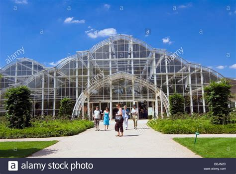 people visiting the glasshouse large greenhouse at rhs wisley garden stock photo royalty free