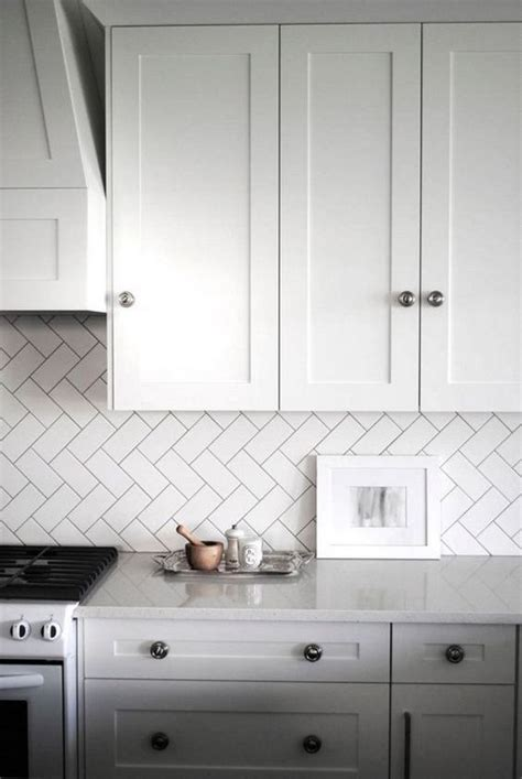 herringbone kitchen backsplash 35 ways to use subway tiles in the kitchen digsdigs