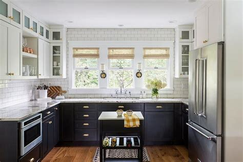 white or black kitchen cabinets black lower cabinets with brass cup pulls transitional