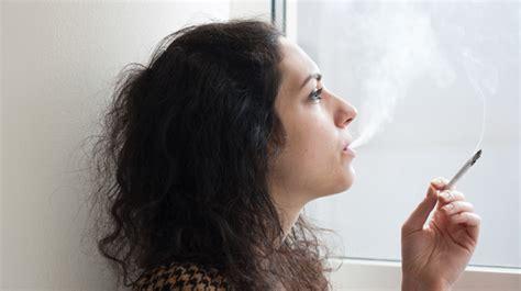a woman smoking marijuana joints study finds marijuana buffers against negative