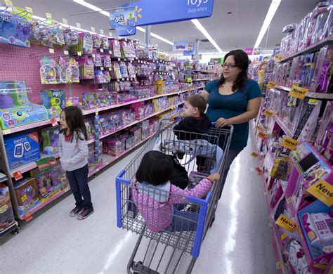 shoo walmart and children shopping for toys