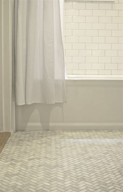herringbone pattern wall tile get rid of the shower curtain white subway tile