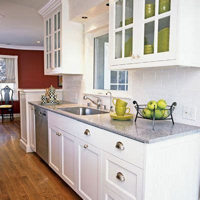 Gray Countertops With White Cabinets by White Cabinets Grey Countertop Kitchens Grey Classic And Glasses