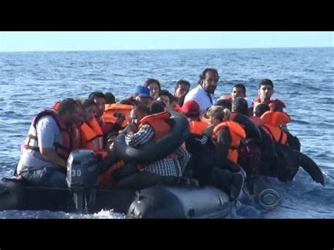 refugee boat video boats from greece confront refugees at sea with guns youtube