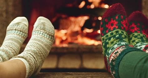 sock fireplace relaxes by warm in woollen socks and a