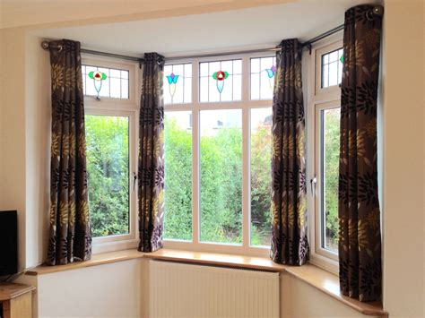 eyelet curtains on bay window bay windows with stained glass bespoke curtains blinds