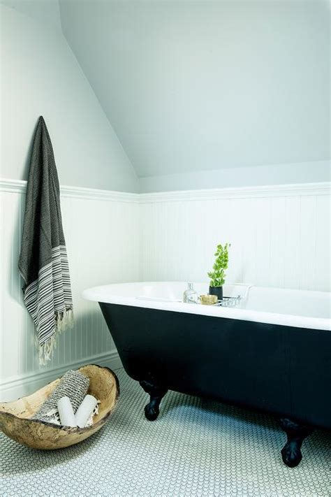 White and Gray Bathroom with Gray Penny Tile Floor