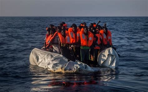 refugee boats to italy some 235 000 migrants ready to cross mediterranean to