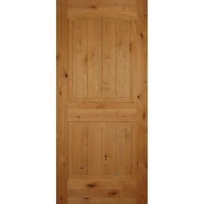 home depot solid core builder s choice 2 panel arch top v grooved solid knotty alder single prehung interior door