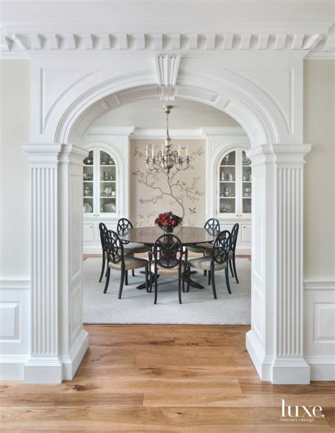 traditional white ornate arch entrance  formal dining