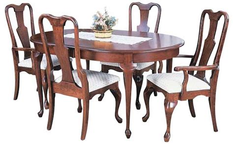 queen anne dining table with self storing leaves by keystone greene prairie woodworks dining amish dining tables