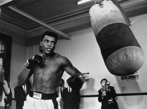 biography about muhammad ali photo august 1966